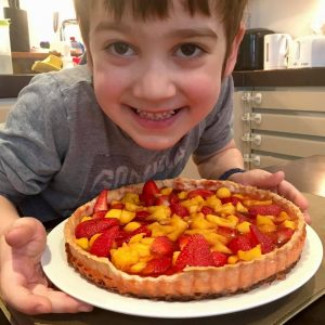 Sebastian with his strawberry and mango tart