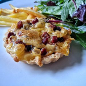 Gluten and dairy free quiches with pancetta, cheese and caramelised onions. Served with chips and salad.