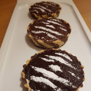Three Chocolate tarts with Zebra striped bases