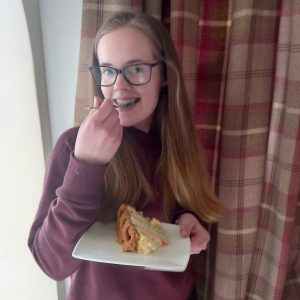 Lady eating a cake with a fork