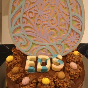 Chocolate cake with the letters EDS on top